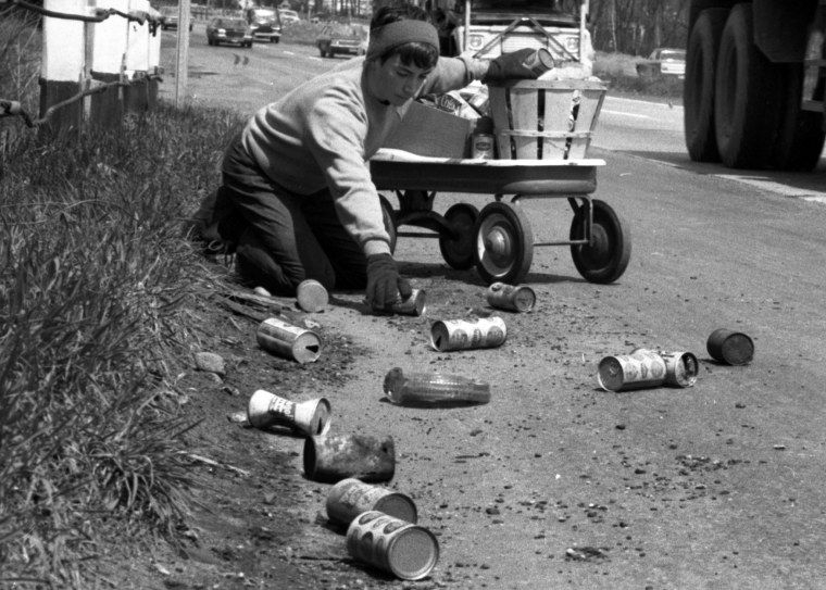 On the first Earth Day, Terry Seuss, 14, cleans up soda and beer cans on Route 17 in Hohokus, N.J., April 22, 1970. (Photo by Jerry Kinstle/NY Daily News/Getty)