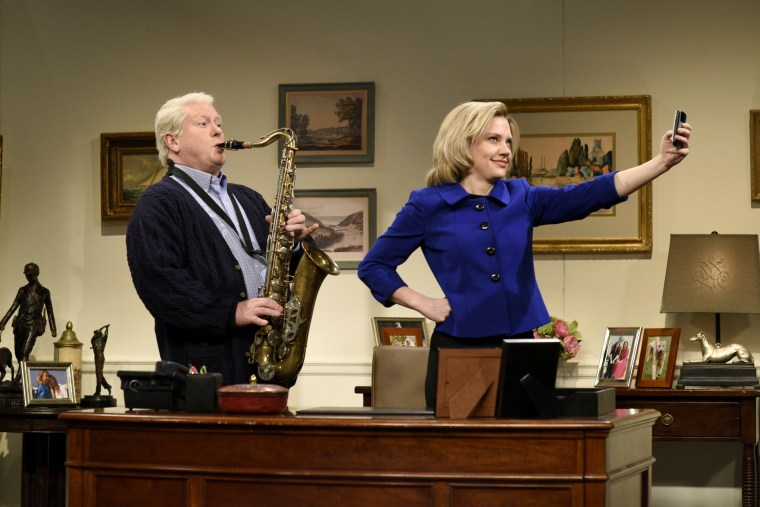 Kate McKinnon plays Hillary Clinton and Darrell Hammond plays Bill Clinton for the opening skit of Saturday Night Live, April 11, 2015. (Photo by Dana Edelson/NBC/NBCU Photo Bank/Getty)