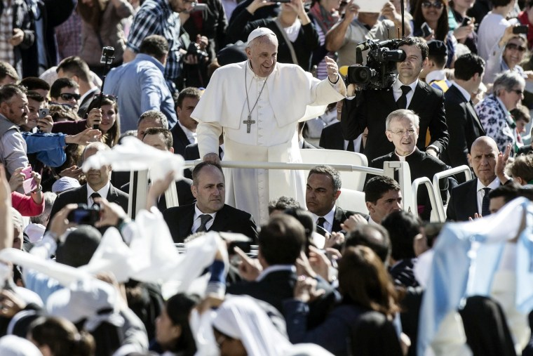 Pope Francis followers as he arrives in St. Peter's Square for his weekly general audience, in the Vatican City on April 22, 2015.