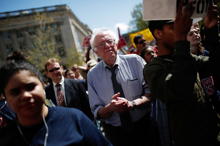 """U.S. Sen. Bernie Sanders (I-VT) participates in a """"Don't Trade Our Future"""" march organized by the group Campaign for America's Future on April 20, 2015 in Washington, DC."""