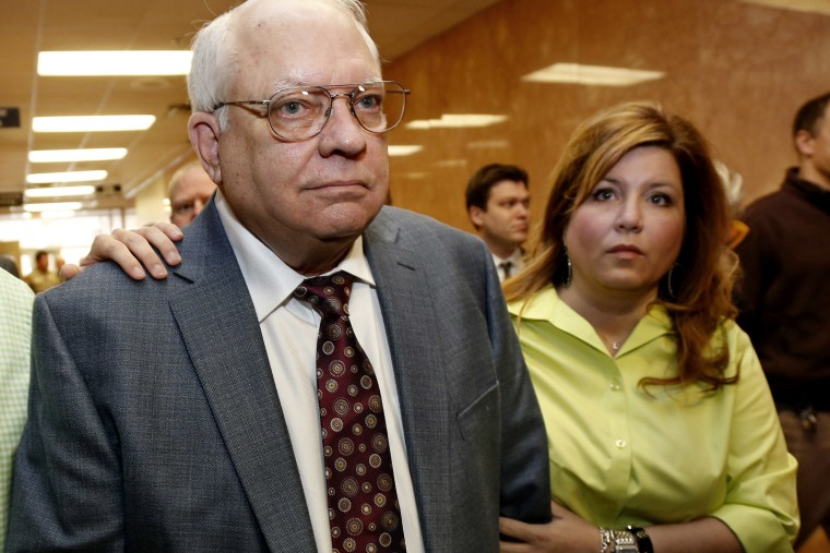 Robert Bates, left, leaves his arraignment with his daughter, Leslie McCreary, right, in Tulsa, Okla., on April 21, 2015. (Photo by Sue Ogrocki/AP)