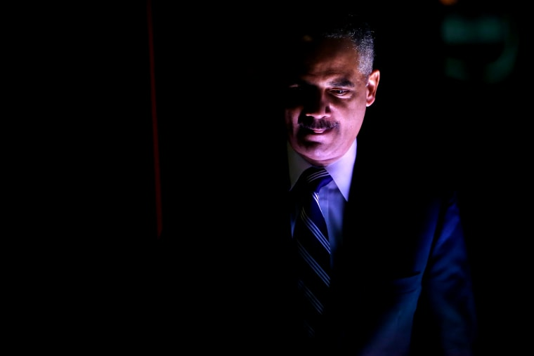 US Attorney General Eric Holder takes the stage to participate in the Washington Ideas Forum, in Washington October 29, 2014. (Photo by Jonathan Ernst/Reuters)