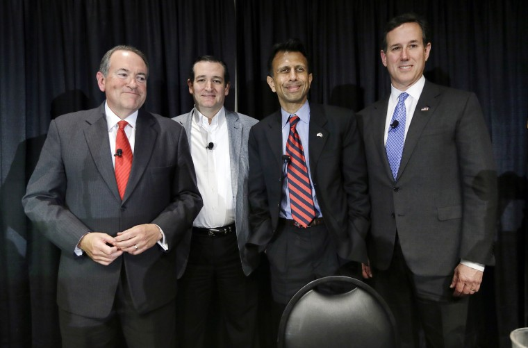 Former Arkansas Gov. Mike Huckabee, from left, Sen. Ted Cruz, R-Texas, Louisiana Gov. Bobby Jindal and former Pennsylvania Sen. Rick Santorum gather on stage after speak at the Homeschool Iowa's Capitol Day, Thursday, April 9, 2015, in Des Moines, Iowa.