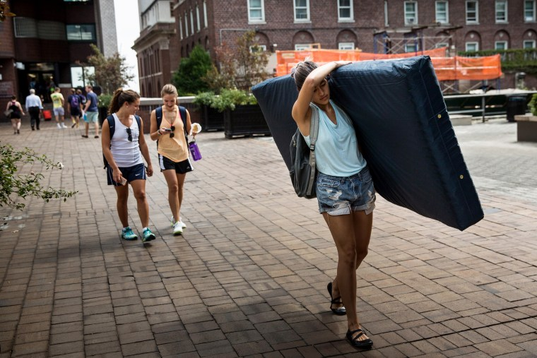 Emma Sulkowicz, a senior visual arts student at Columbia University, carries a mattress in protest of the university's lack of action after she reported being raped during her sophomore year on Sep. 5, 2014 in New York City. (Photo by Andrew Burton/Getty)