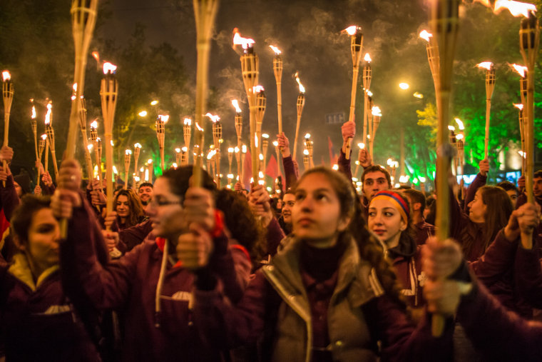 People participate in a torchlight procession through the city to commemorate the anniversary of the Armenian genocide on April 24, 2015 in Yerevan, Armenia. (Photo by Brendan Hoffman/Getty)