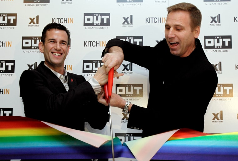 Ian Reisner, left, and Mati Weiderpass, co-owners of The Out NYC hotel, cut the ribbon for New York's new gay resort hotel, March 1, 2012. (Photo by Richard Drew/AP)