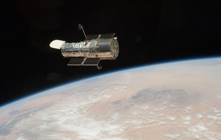In this Tuesday, May 19, 2009 photo released by NASA, the Hubble Space Telescope is seen from the Space Shuttle Atlantis.