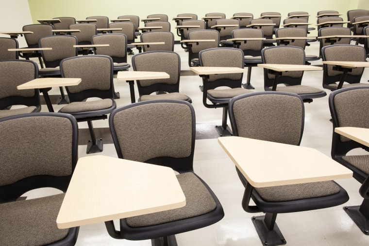 Seats in empty lecture hall.