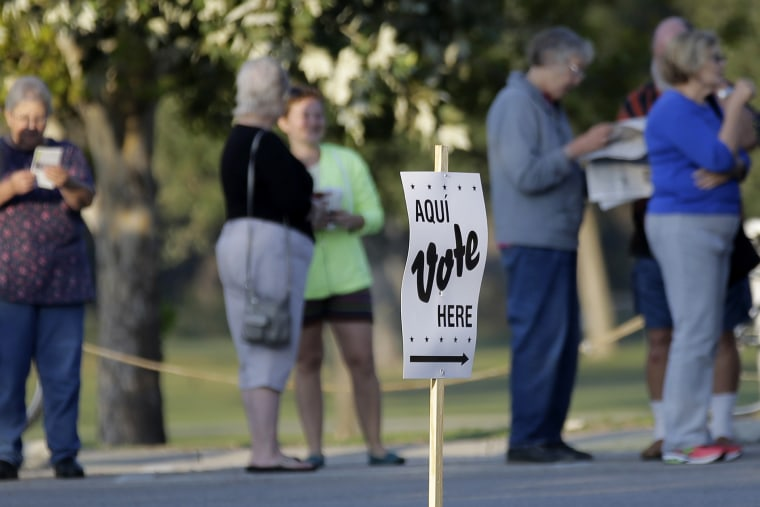 Voters stand in line to vote at an early voting polling site on Oct. 20, 2014, in San Antonio, Texas.