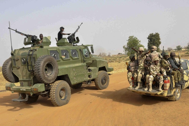 A photograph made available on March 8 2015 shows the Nigerian army patrolling in Chibok, Borno State, North Eastern Nigeria on March 5, 2015. (Photo by Henry Ikechukwu/EPA)