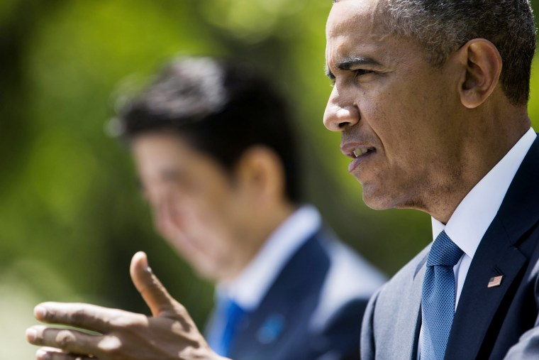 US President Barack Obama (R) speaks at a joint press conference with Shinzo Abe (L), Prime Minister of Japan, in the Rose Garden of the White House in Washington DC on April 28, 2015.