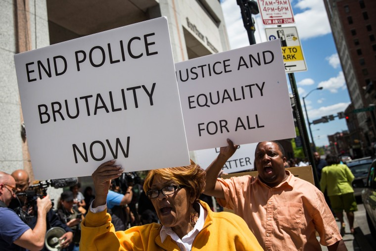People participate in a rally for the family of Freddie Gray outside the Maryland state's attorney's office on April 29, 2015 in Baltimore, Md. (Photo by Andrew Burton/Getty)