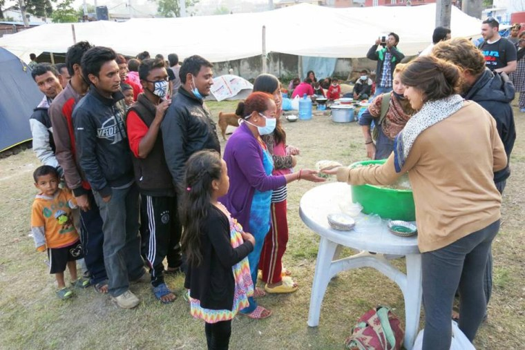 A group of volunteers with Chabad-Lubavitch of Nepal distribute hot food to hundreds of hungry Nepalese citizens on Wednesday, April 29 in Kathmandu, Nepal. (Photo by Chabad.org/Chabad of Nepal)