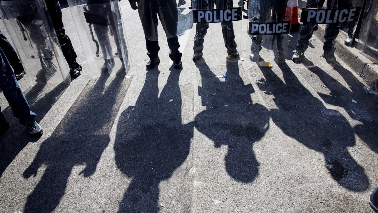 Police gather at North Ave and Pennsylvania Ave in Baltimore, Md., April 28, 2015. (Photo by Eric Thayer/Reuters)