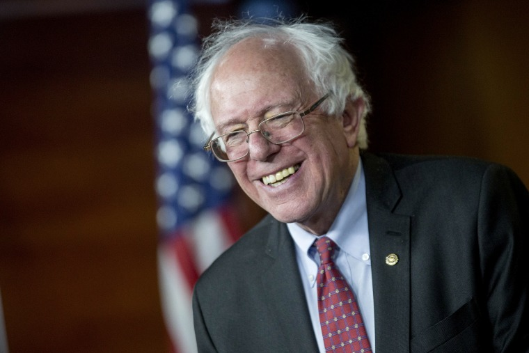 Senator Bernie Sanders, an Independent from Vermont, smiles while responding to a question during a news conference on Capitol Hill in Washington, DC, April 29, 2015. (Photo by Andrew Harrer/Bloomberg/Getty)