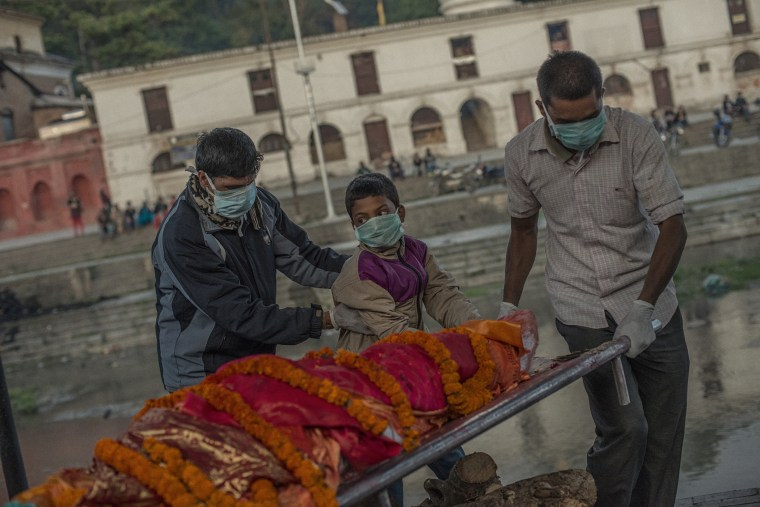 Young Raj Kumar Khatri carrird the body of his mother body before cremation.