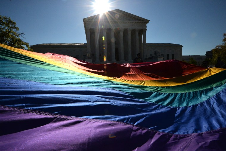 Supporters of same-sex marriages gather outside the US Supreme Court waiting for its decision on April 28, 2014 in Washington, D.C. (Photo by Mladen Antonov/AFP/Getty)