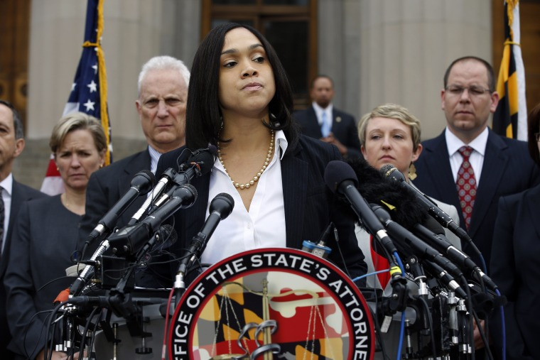Marilyn Mosby, Baltimore state's attorney, pauses while announcing criminal charges against all six officers suspended after Freddie Gray suffered a fatal spinal injury in police custody, May 1, 2015 in Baltimore, Md. (Photo by Alex Brandon/AP)