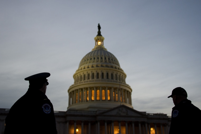 U.S. Capitol Police stand guard in front of the U.S. Capitol in Washington, D.C. (Photo by Jim Watson/AFP/Getty)