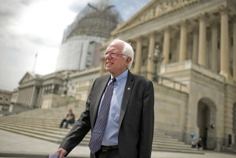 Presidential candidate Sen. Bernie Sanders, I-Vt., makes his way a news conference at the Senate swamp to speak about his agenda for the country, April 30, 2015. (Photo By Tom Williams/CQ Roll Call/Getty)