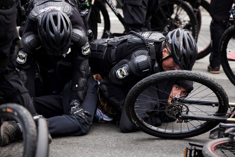 Police detain a demonstrator during an anti-capitalist protest in Seattle, Wash., May 1, 2015. (Photo by David Ryder/Reuters)