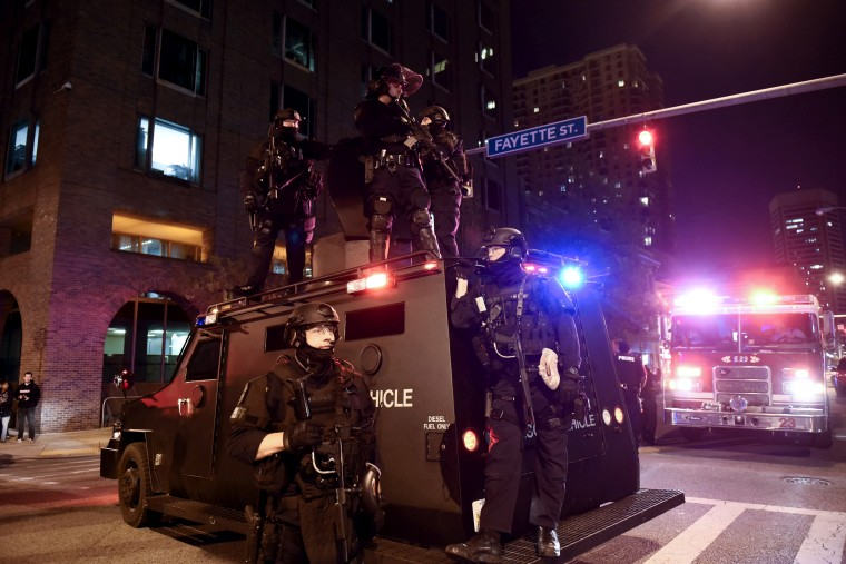 A police unit blocks the intersection of Guilford Avenue and Fayette Street near City Hall in Baltimore, May 1, 2015. (Photo by Sait Serkan Gurbuz/Reuters)