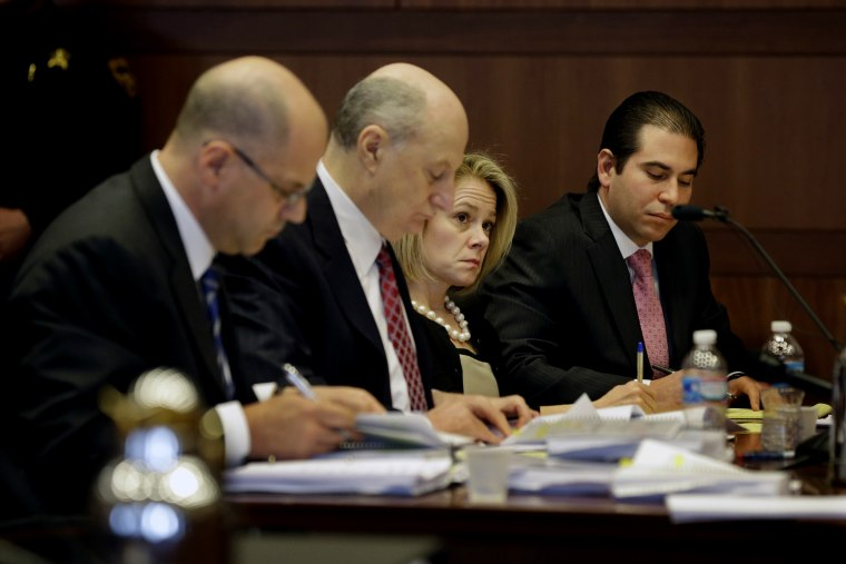 New Jersey Gov. Chris Christie's former Deputy Chief of Staff Bridget Anne Kelly sits with her attorneys in court while waiting for a hearing on March 11, 2014 in Trenton, NJ. (Photo by Mel Evans/Pool/Getty)