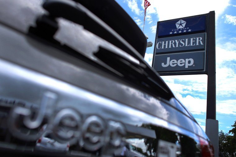 A Chrysler Jeep sign is seen outside a Chrysler Jeep car dealership in Hollywood, Fla. (Photo by Joe Raedle/Getty)