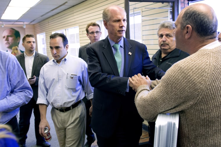 Dan Donovan, center, currently the district attorney of the Staten Island borough of New York, greets a supporter in one of two campaign offices opened Sunday, March 22, 2015. (Photo by Craig Ruttle/AP)
