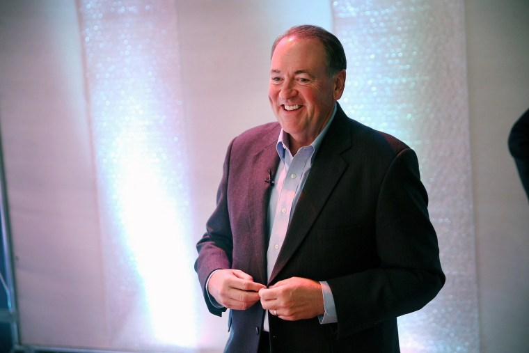 Former Arkansas Governor Mike Huckabee prepares to speak to guests gathered at the Point of Grace Church for the Iowa Faith and Freedom Coalition 2015 Spring Kickoff on April 25, 2015 in Waukee, Iowa. (Photo by Scott Olson/Getty)