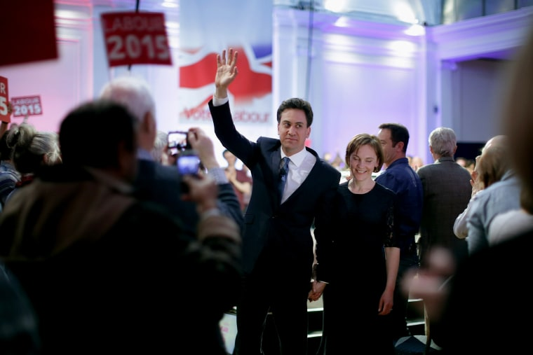 Labour leader Ed Miliband waves goodbye to supporters as he and his wife Justine Thornton leave a campaign rally at the Royal Horticultural Halls on May 2, 2015 in London, United Kingdom. (Photo by Chip Somodevilla/Getty)