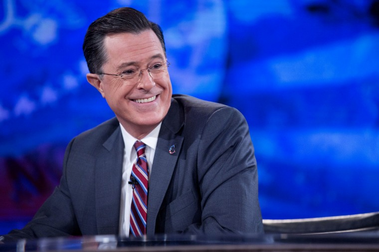 """Stephen Colbert smiles while taping the """"The Colbert Report"""" with United States President Barack Obama in Lisner Auditorium on the campus of George Washington University in Washington, D.C., Dec. 8, 2014. (Photo by Andrew Harrer/picture-alliance/dpa/AP)"""