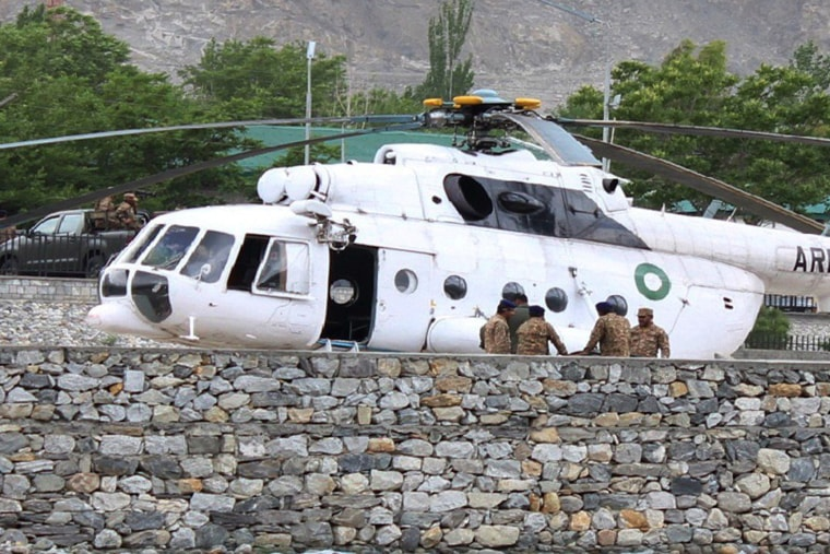 Pakistani soldiers gather beside an army helicopter at a military hospital where victims of a helicopter crash were brought for treatment in Gilgit on May 8, 2015. (Photo by Farman Karim/AFP/Getty)