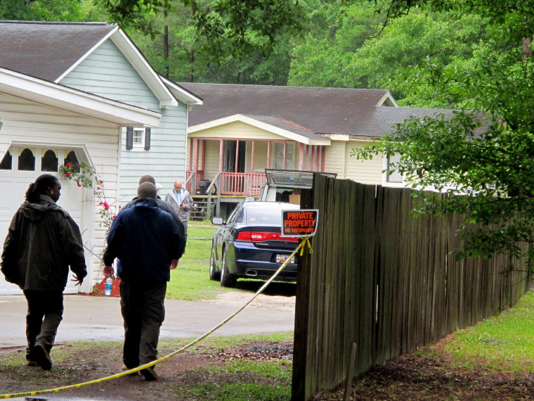 Investigators work at a scene of a shooting in Hollywood, SC., May 7, 2015. (Photo by Bruce Smith/AP)