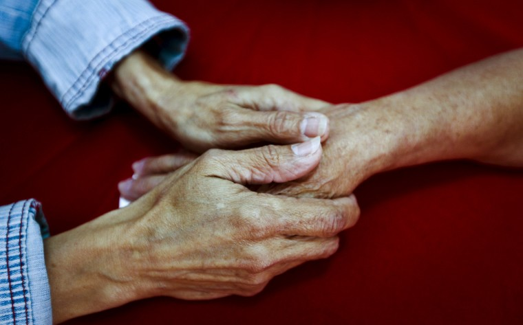Rosa Elba Lacosta Sanchez Del Campo (L), 57, holds the hand of her mother Caridad Sanchez Del Campo Matos, 83, from Cuba, in La Galena, on the Spanish Canary island of Tenerife, Spain, April 1, 2015. (Photo by Santiago Ferrero/Reuters)