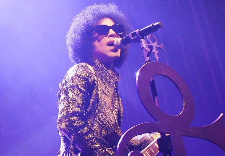"""Prince performs onstage during the """"HitnRun"""" tour at The Fox Theatre on April 9, 2015 in Detroit, Mich. (Photo by Chelsea Lauren/NPG Records 2015/Getty)"""