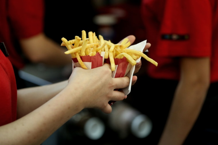 An employee collects two portions of french fries for a customer inside a Burger King restaurant. (Photo by Andrey Rudakov/Bloomberg/Getty)
