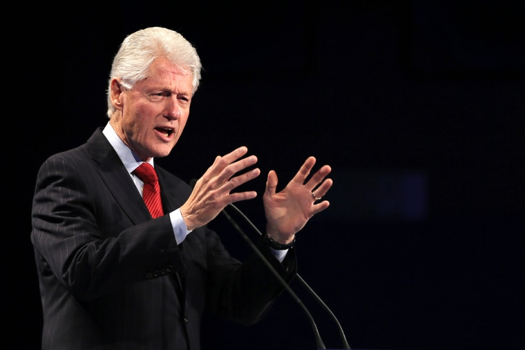 Former President of the United States Bill Clinton talks to the audience during the Global Teacher Prize ceremony in Dubai, United Arab Emirates, March 15, 2015. (Photo by Kamran Jebreili/AP)