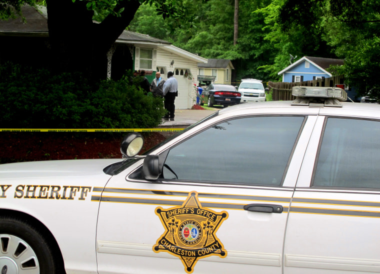 Investigators work at a scene of a shooting in Hollywood, S.C., May 7, 2015. A sheriff's deputy responding to a home invasion shot the homeowner in the neck Thursday because he refused to drop his gun, authorities said. (Photo by Bruce Smith/AP)