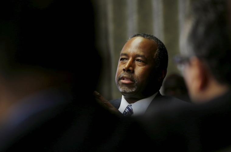 Republican presidential candidate Ben Carson talks to pastors and community leaders during a meeting at the Bilingual Church in Baltimore, Md., May 7, 2015. (Photo by Carlos Barria/Reuters)