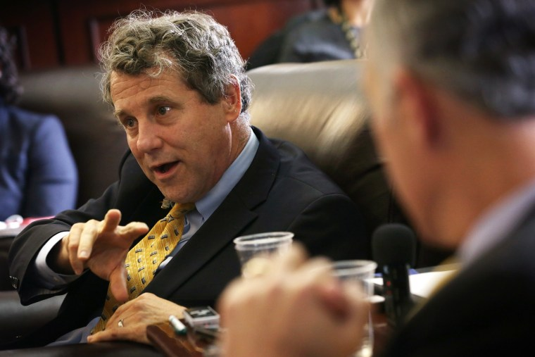 U.S. Sen. Sherrod Brown (D-OH) speaks to members of the media April 23, 2015 on Capitol Hill in Washington, DC.