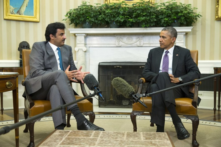 President Barack Obama meets with the Emir of Qatar Sheikh Tamim bin Hamad al Thani, on Feb. 24, 2015, in the Oval Office of the White House in Washington. (Photo by Evan Vucci/AP)