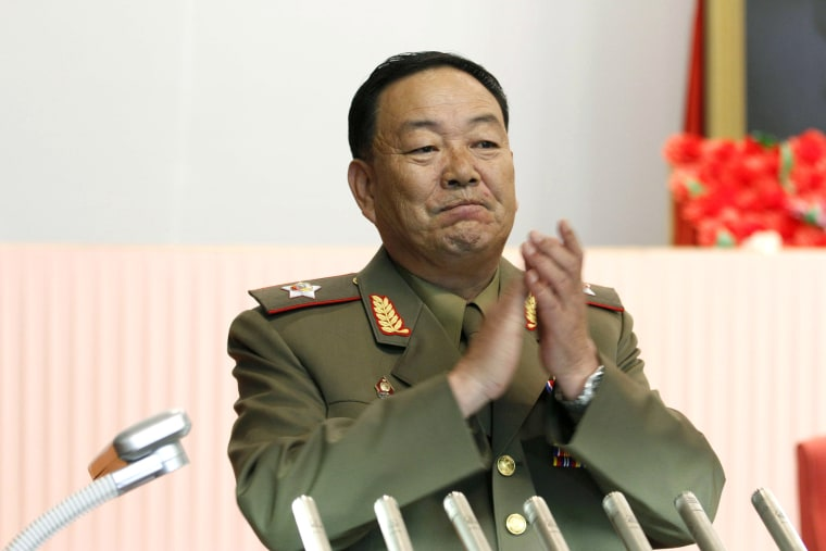 Vice Marshal Hyon Yong Chol applauds during a meeting at the April 25 House of Culture announcing North Korean leader Kim Jong Un's new title of marshal, July 18, 2012, in Pyongyang, North Korea. (Photo by Jon Chol Jin/AP)