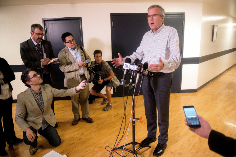 Former Florida Governor Jeb Bush talks with the media after speaking at a town hall meeting in Reno, Nevada on May 13, 2015.