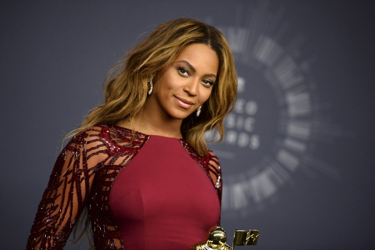 Beyonce poses with her Video Vanguard Award in the press room at the MTV Video Music Awards at The Forum on Aug. 24, 2014, in Inglewood, Calif. (Photo by Jordan Strauss/Invision/AP)