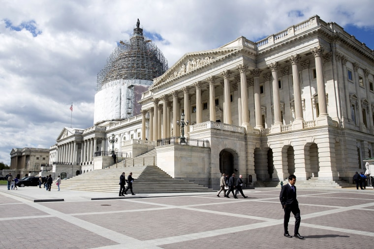 A man walks in front of the U.S. Capitol in Washington on April 23, 2015.
