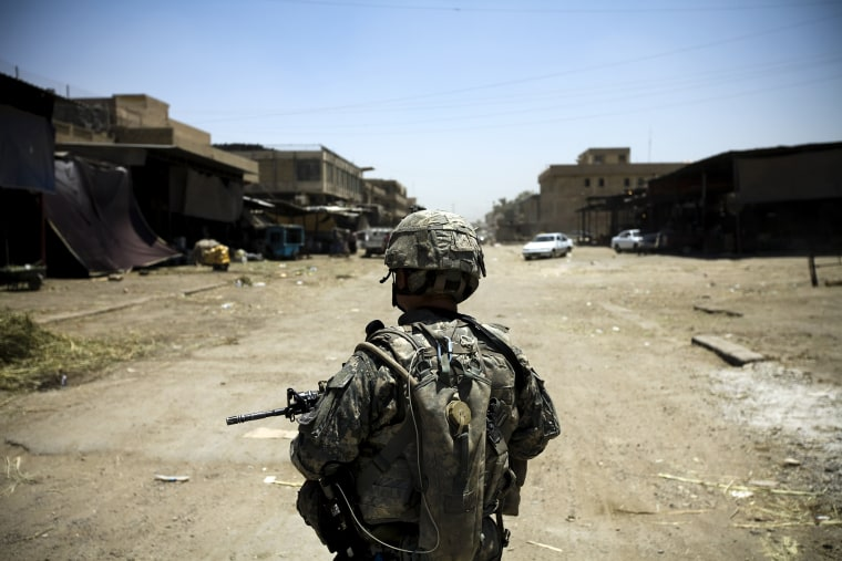 An American soldier on patrol in Jamilla Market on July 15 2008 in Sadr City, Iraq. (Photo by Benjamin Lowy/ Getty)
