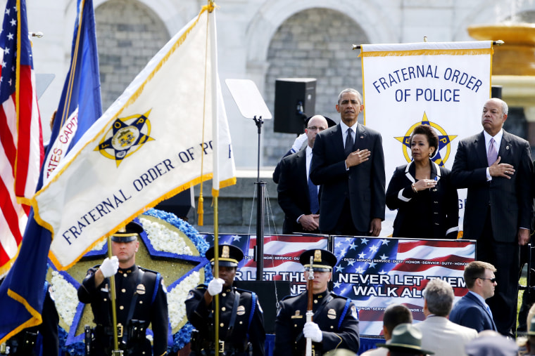 U.S. President Barack Obama, Attorney General Loretta Lynch and Homeland Security Secretary Jeh Johnson stand for the national anthem at the National Peace Officers' Memorial Service in Washington May 15, 2015. (Photo by Jonathan Ernst/Reuters)