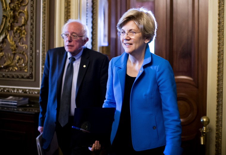 Sen. Bernie Sanders, I-Vt., and Sen. Elizabeth Warren, D-Mass., leave the Senate Democrats' policy luncheon on, May 12, 2015. (Photo By Bill Clark/CQ Roll Call/Getty)