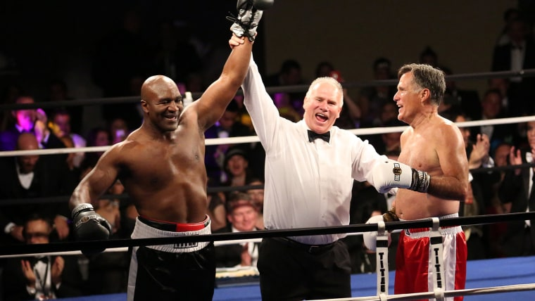 Boxing champion Evander Holyfield is declared the winner against Former Republican presidential candidate Mitt Romney during a charity fight night event on May 15, 2015, in Salt Lake City, Ut. (Photo by Kristin Murphy/Deseret News via AP)